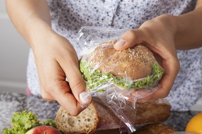 Woman wrapping up sandwich for school lunch