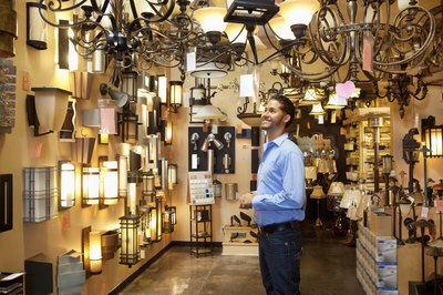 Man browsing light fixtures at store.