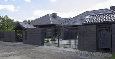 A dark house with a gray roof can look sleek and modern/