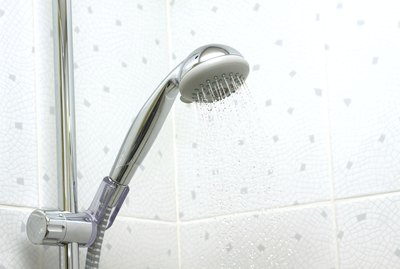 Accessible showers must provide a shower head on a flexible hose that is at least 60 inches long.