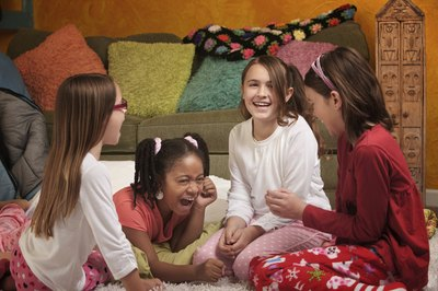 Girls at a slumber party playing a game
