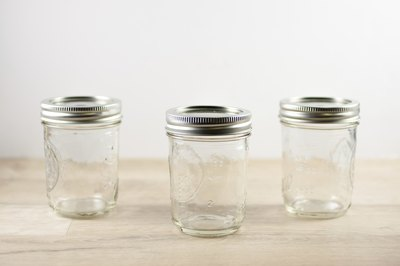 Three empty canning jars.
