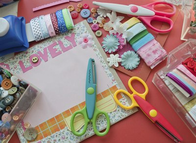 Materials and supplies to make a scrapbook.