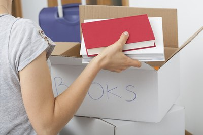 Woman packing boxes of books