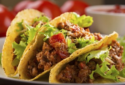 Tacos with lettuce and tomato.