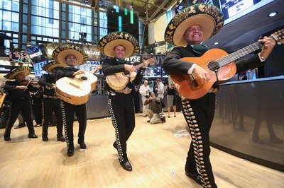 A mariachi band strolling through a building.