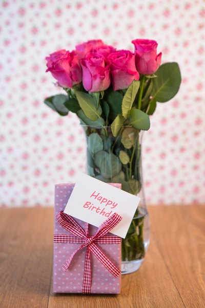 Bouquet of flowers, card and present