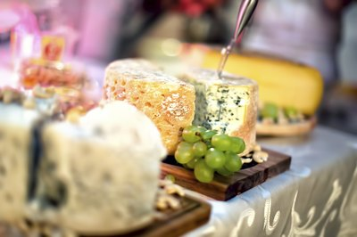 Variety of cheeses on a dining table