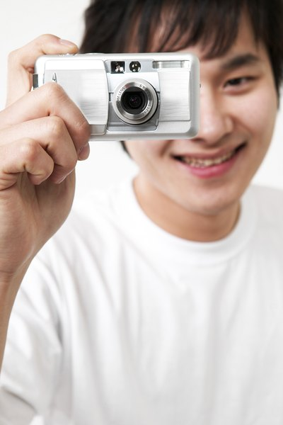 Boy holding digital camera