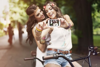Girls taking photo of themselves with hippie look
