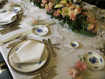 a set table of matching antique dinner-ware
