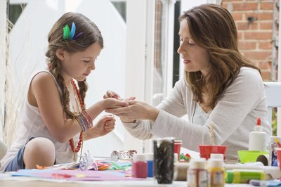 Girl making crafts with Mom