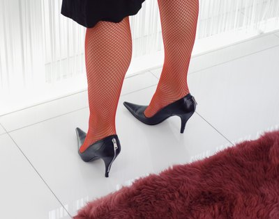 red fishnets and black stileto heels
