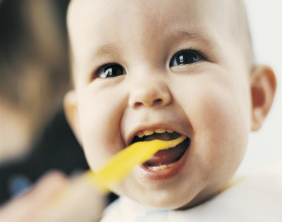 Baby eating yogurt
