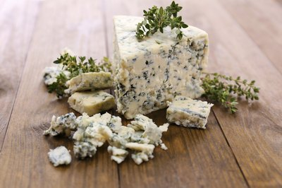 Crumbled blue cheese on table