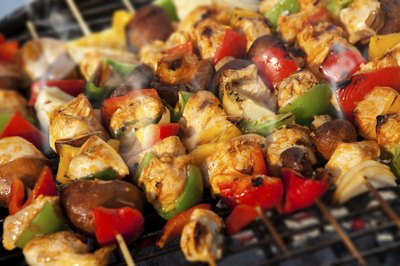 Skewers cooking on a barbecue grill