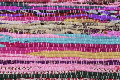 Close-up of a colorful braided rug.