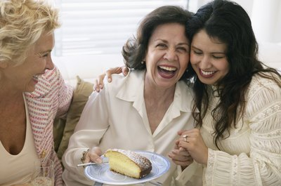 Woman laughing with cake