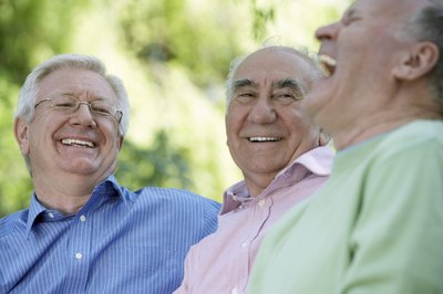 men laughing 50th high school reunion
