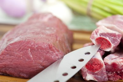 Beef being cut up with knife