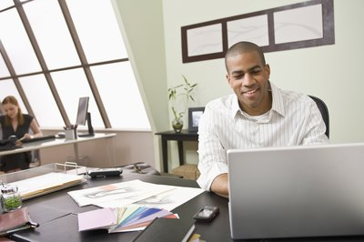 Man smiling at desk in office