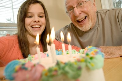 Man celebrating birthday with granddaughter