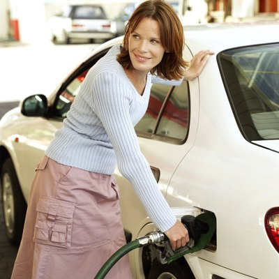 Filling her tank with a gas gift card for a road trip.
