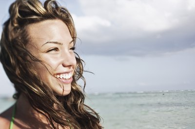 Teenage girl smiling at beach