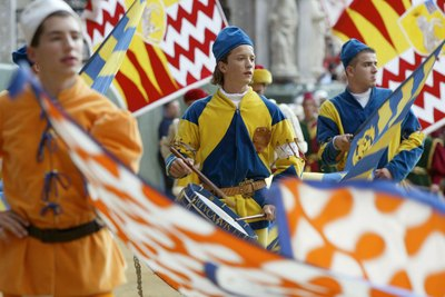 Standard bearers in traditional medieval costumes in Siena, Italy