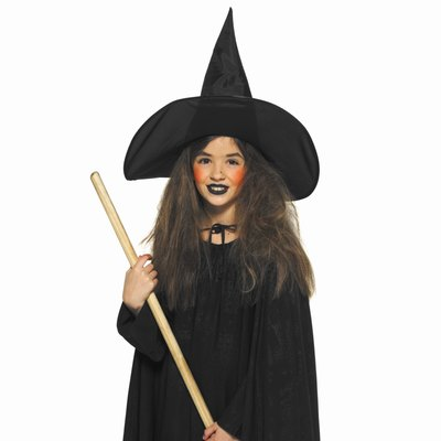 Medieval witches carry plain corn brooms.