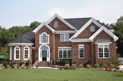 Exterior of a beautiful brick home with garden