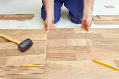 Man installing wood laminate floor