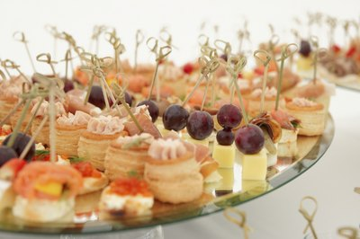 Various cheese and seafood appetizers on serving dish