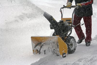 A man using a snowblower