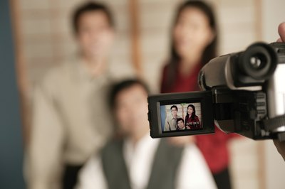 Ask a friend or family member with a camcorder to record the christening party.