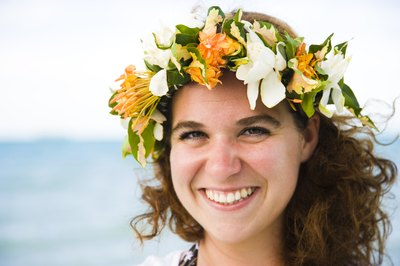 Young bride wearing floral lei crown at bridal shower.