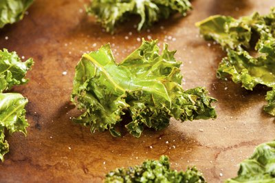 A close-up of Kale chips with sea salt.
