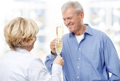 Senior couple toasting champagne