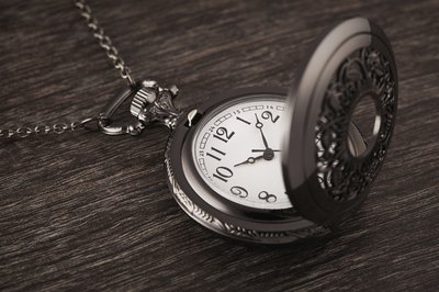 Pocket watch on wood table