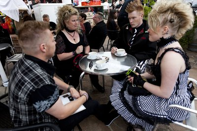 Goth music festival attendees take a refreshment break