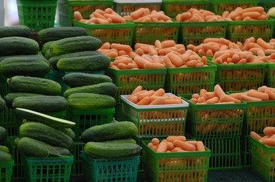 Cucumbers and carrots are both safe veggies for dogs to eat.