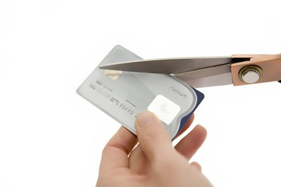 Cut up your credit cards to avoid the temptation to charge more.