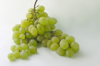 Grapes are healthy for fancy goldfish when fed in small quantities.