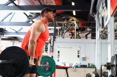 Force your hips through at the top of the deadlift to activate your glutes.
