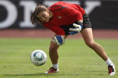 U.S. national team keeper Hope Solo saves the ball during a training session.