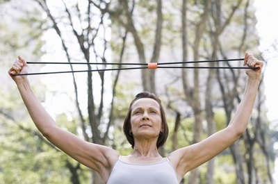 Resistance tube arm exercises add strength training to walking.