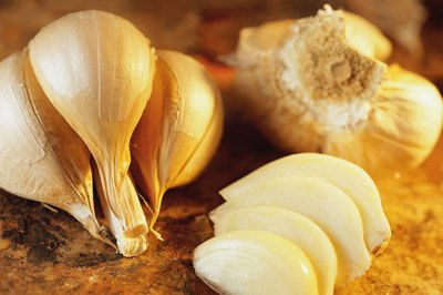 Try eating fresh garlic to reduce excess mucus.