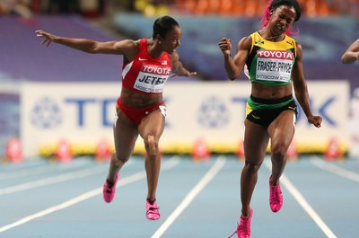 Shelly-Ann Fraser-Pryce edges Carmelita Jeter in the women's 100 meters in Moscow in 2013.