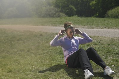A soft tuft of grass is ideal for an outdoor ab workout.