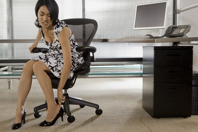 Bring a tennis ball to work to massage your arch while you sit at your desk.